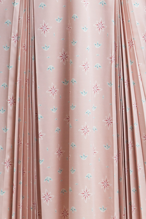 Powder pink printed midi dress with flared sleeves and pleats