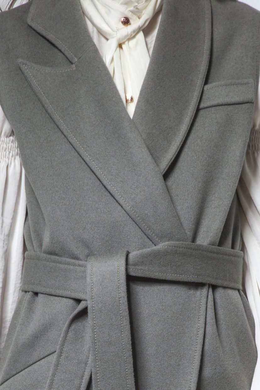Olive green cashmere vest with belt and snap closure