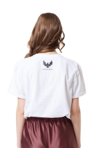 White crew neck T-shirt with rolled sleeves and a logo at the back. by DIANA ARNO