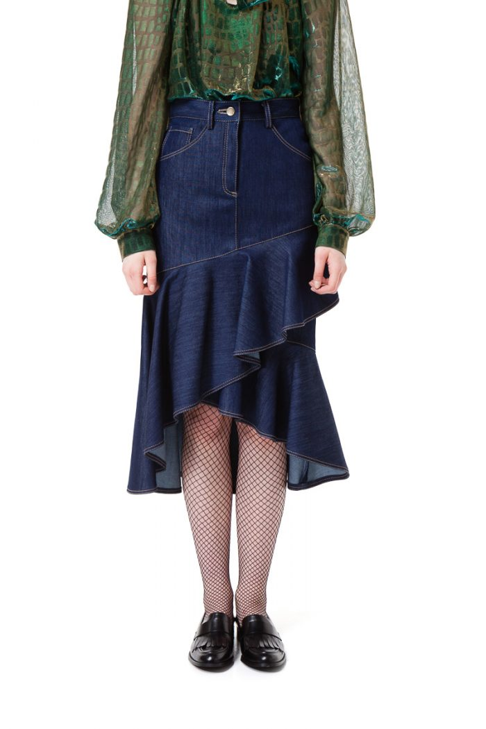 NORA denim skirt with ruffled asymmetrical hem by DIANA ARNO.