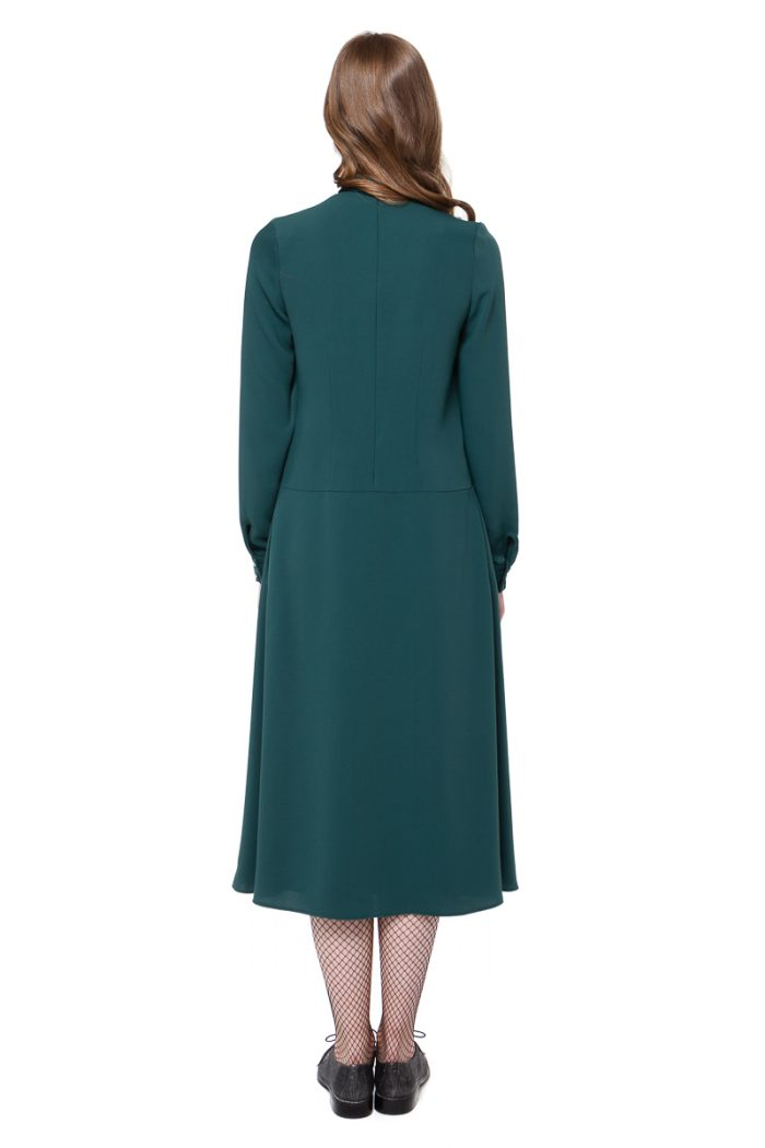 CLAUDIA swing dress in dark forest green with a twist neck detail by DIANA ARNO.