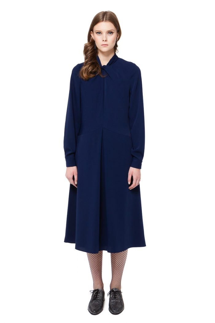 CLAUDIA swing dress in dark autumn blue with a twist neck detail by DIANA ARNO.