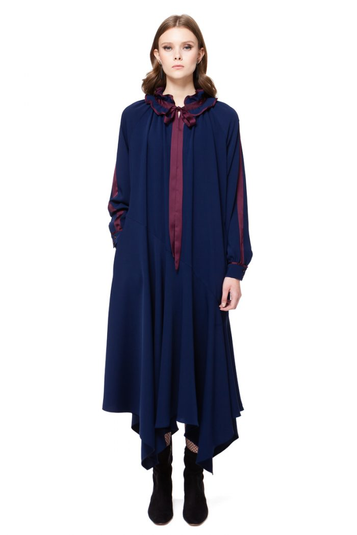 ALEXA asymmetrical dress with a bow and ruffled statement collar in Merlot by DIANA ARNO.