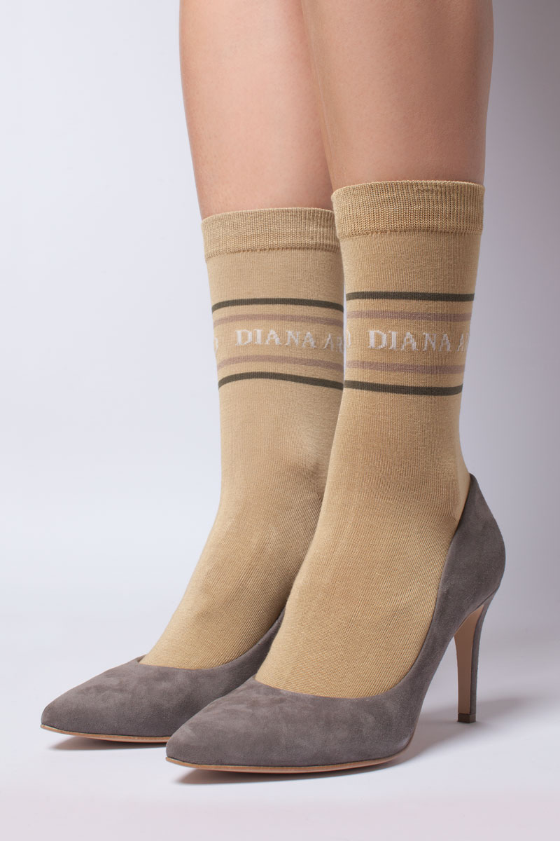 Socks with DIANA ARNO logo in sandy beige. Made from durable mercerised cotton and fit all sizes from 36 to 40. Shop on dianaarno.com.
