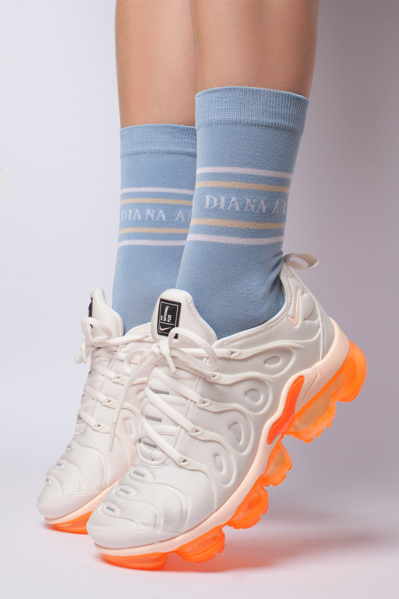 Socks with DIANA ARNO logo in heavenly blue. Made from durable mercerised cotton and fit all sizes from 36 to 40. Shop on dianaarno.com.