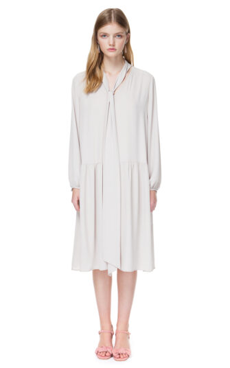 ELLIE tie neck dress with long sleeves in pleasing ivory nude.