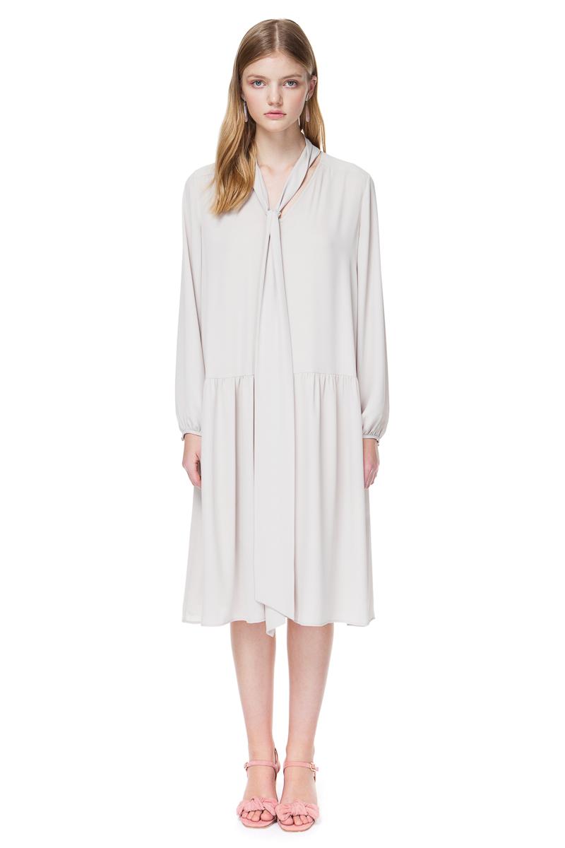 ELLIE tie neck dress with long sleeves in pleasing ivory nude.