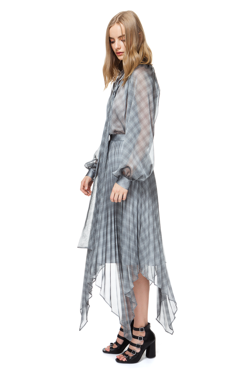 LOLA asymmetrical pleated skirt in grey check with handkerchiefhemline.