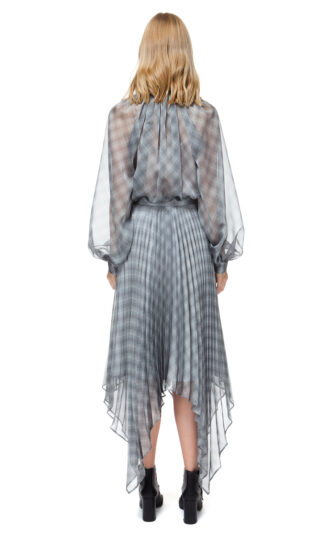 LOLA asymmetrical pleated skirt in grey check with handkerchief hemline.